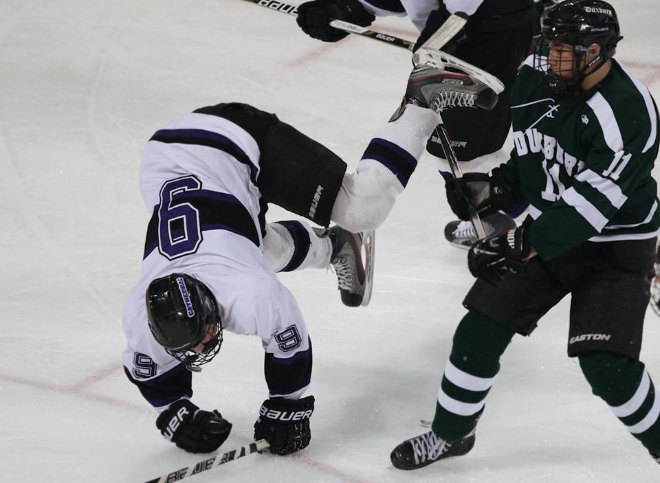 Springfield Cathedral's Zac Prattson got upended by Matt Saia of Duxbury.